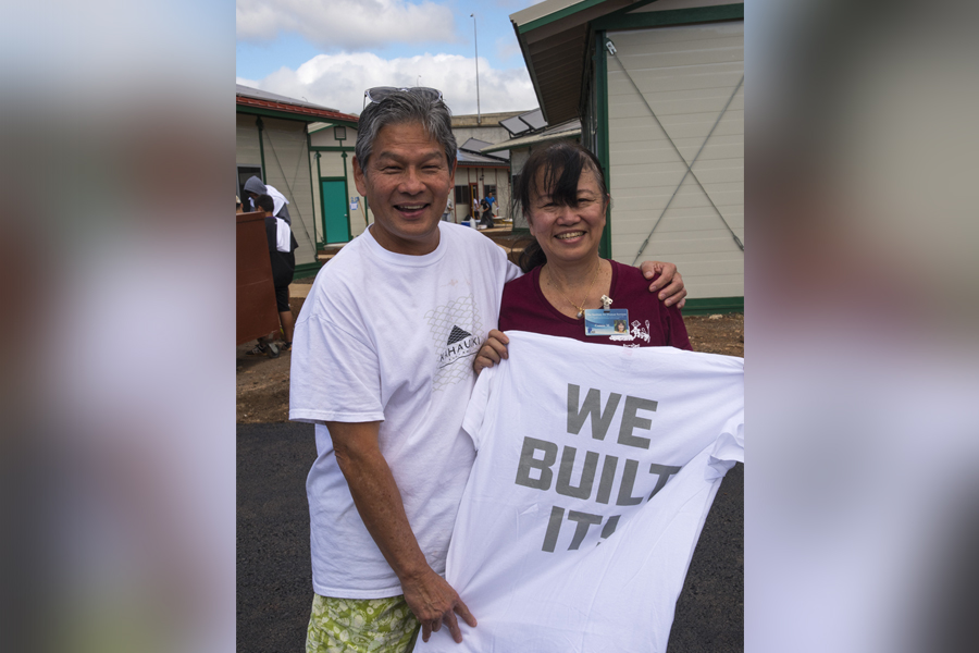 "Cover photo of Duane Kurisu and Connie Mitchell holding a t-shirt that reads, ""We Built It!"""