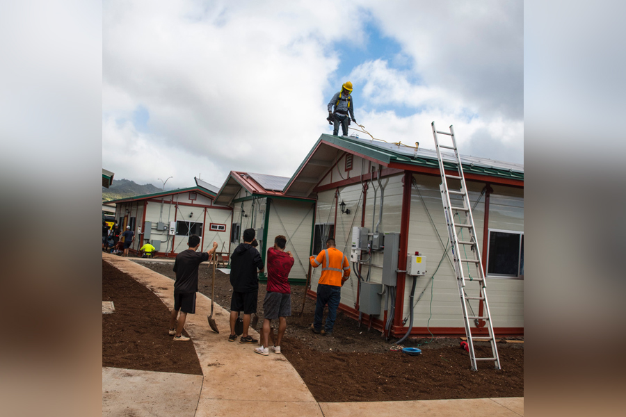 Student volunteers cleaned up as other construction professionals put the final touches on Kahauiki Village a week before the grand opening.