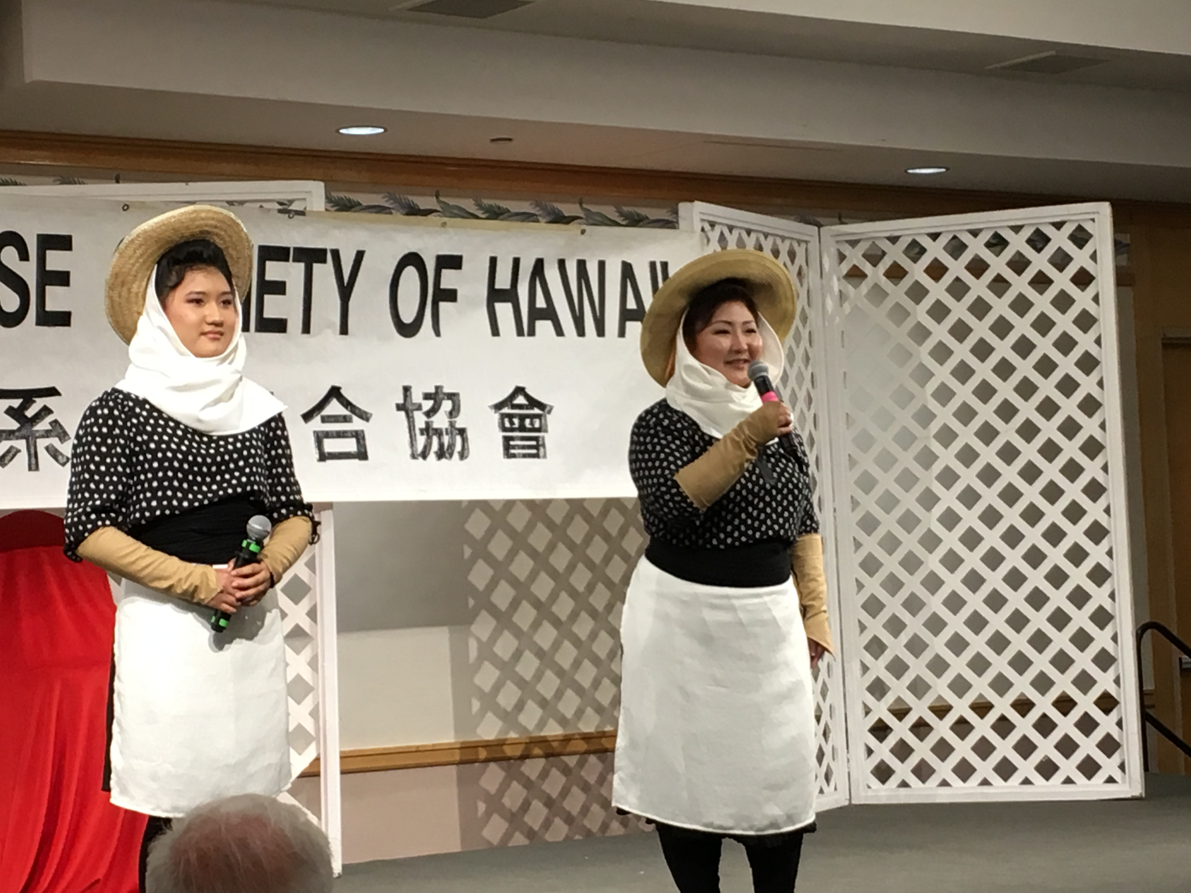 Leslie Matsumoto Tyson (right) and her niece Aolani Silva sang a holehole bushi in women's plantation outfits.