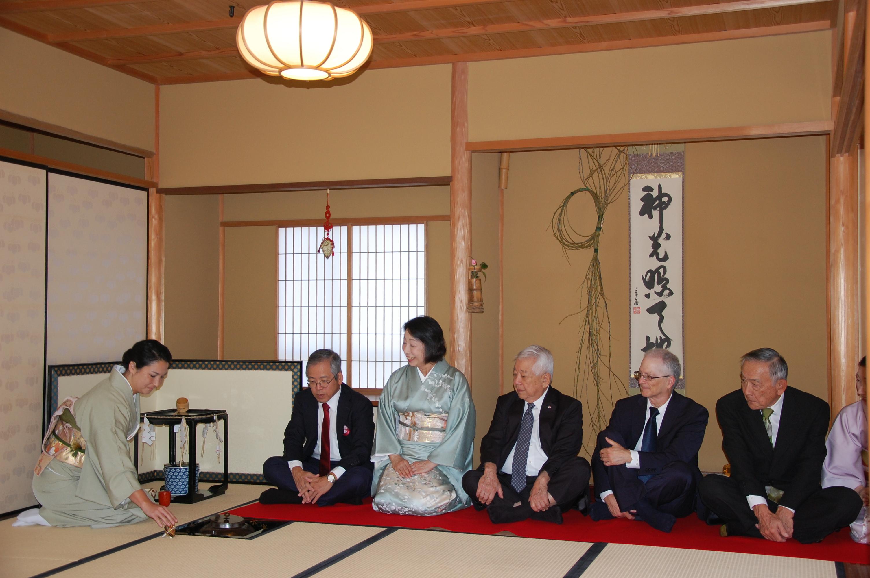 Teishu (tea ceremony host) Kae Pusic-Sanada prepared tea for guests (from left): Consul General Koichi Ito, Mrs. Misako Ito, Dr. Satoru Izutsu, Dr. Robert Huey and Akemi Kurokawa at the Chado Urasenke Tankokai Association's Hatsudate Shiki.