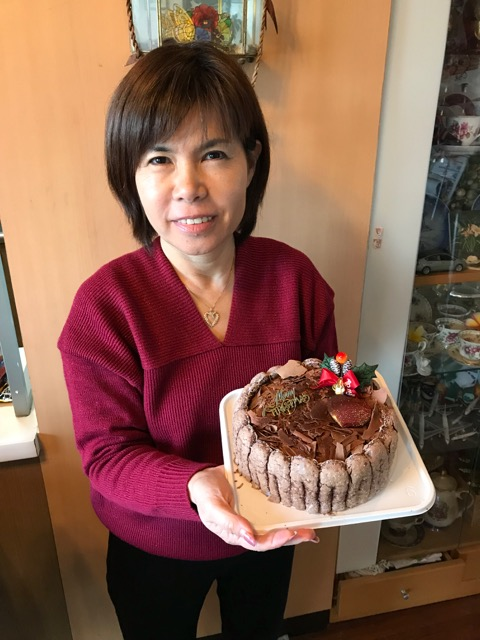Photo of Colin Sewake's wife, Keiko, with the Jimmy's Bakery double tiramisu cake we ordered for Christmas.