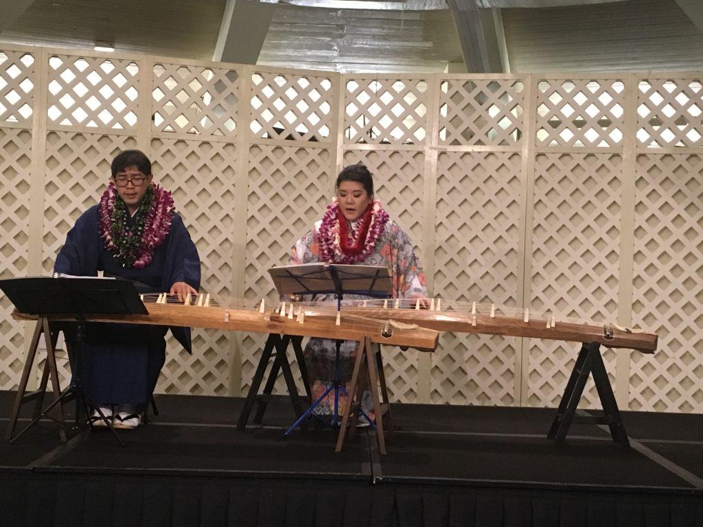 "Newly installed Ryukyu Sokyoku Koyo Kai Hawaii Shibu leaders Derek Fujio and Sara Nakatsu perform ""Guin Bushi"" for the audience. Fujio is a student of Jane Kaneshiro-Sensei, and Nakatsu is Bonnnie Miyashiro-Sensei's student."