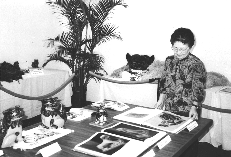 June Arakawa was one of the first members of Hui O Laulima when it organized in 1968. Arakawa is pictured with a cultural display organized by Hui O Laulima at the then-Honolulu Academy of Arts. (Hawai'i Herald Archives)