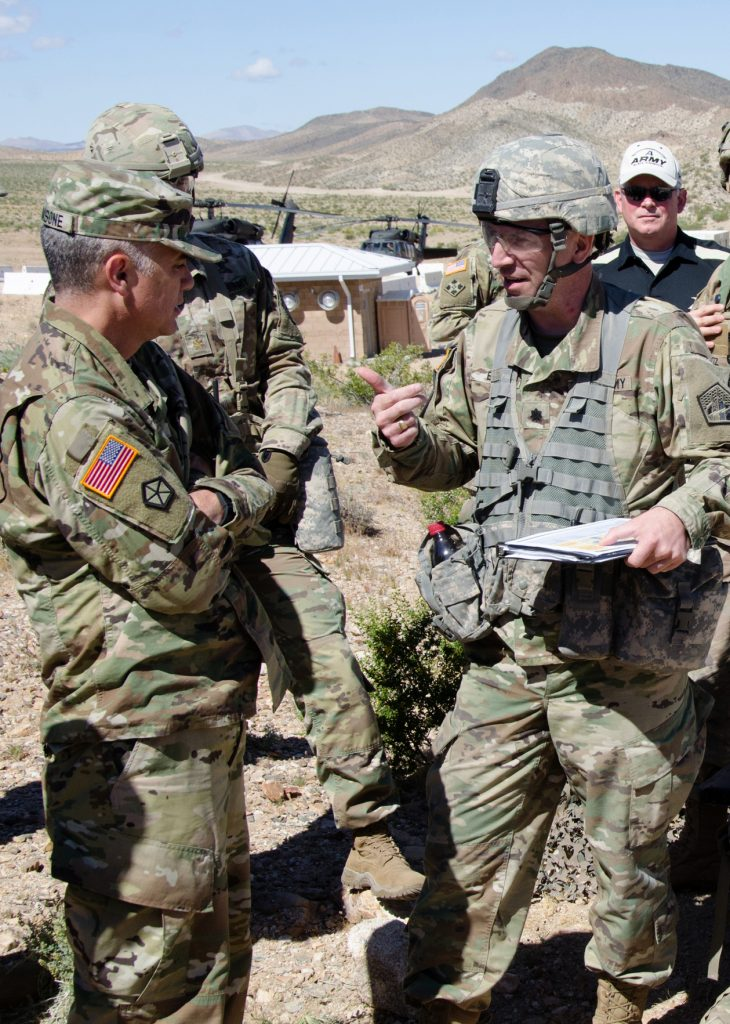 Lt. Col. Jonathan Burnett, chief of Army Cyber Command's Cyber-Electromagnetic Activities (CEMA) division, briefs ARCYBER commander Lt. Gen. Paul M. Nakasone about CEMA operations at the National Training Center at Fort Irwin, Calif., May 7, 2017. ARCYBER units were at NTC participating in a training rotation for the 2nd Armored Brigade Combat Team, 1st Infantry Division, as part of the ARCYBER-led CEMA Support to Corps and Below initiative. The CSCB program is designed to help the Army define and develop cyberspace doctrine, organization, enabling support and integration into tactical units, in synchronization with related warfighting disciplines such as electronic warfare, information operations, network operations and intelligence. (Photo by Bill Roche)