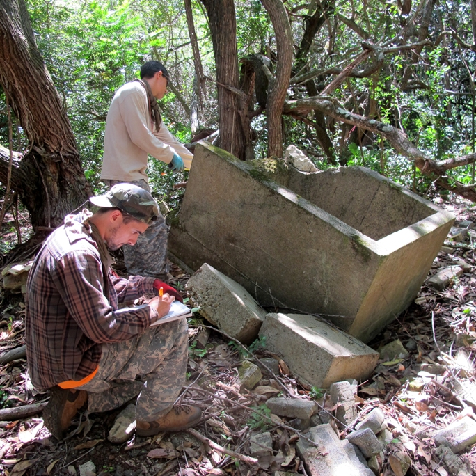 In 2014, Army investigators sift through the remains of what was a prisoner of war camp at Schofield Barracks from 1944 to 1945. (U.S. Army photo)