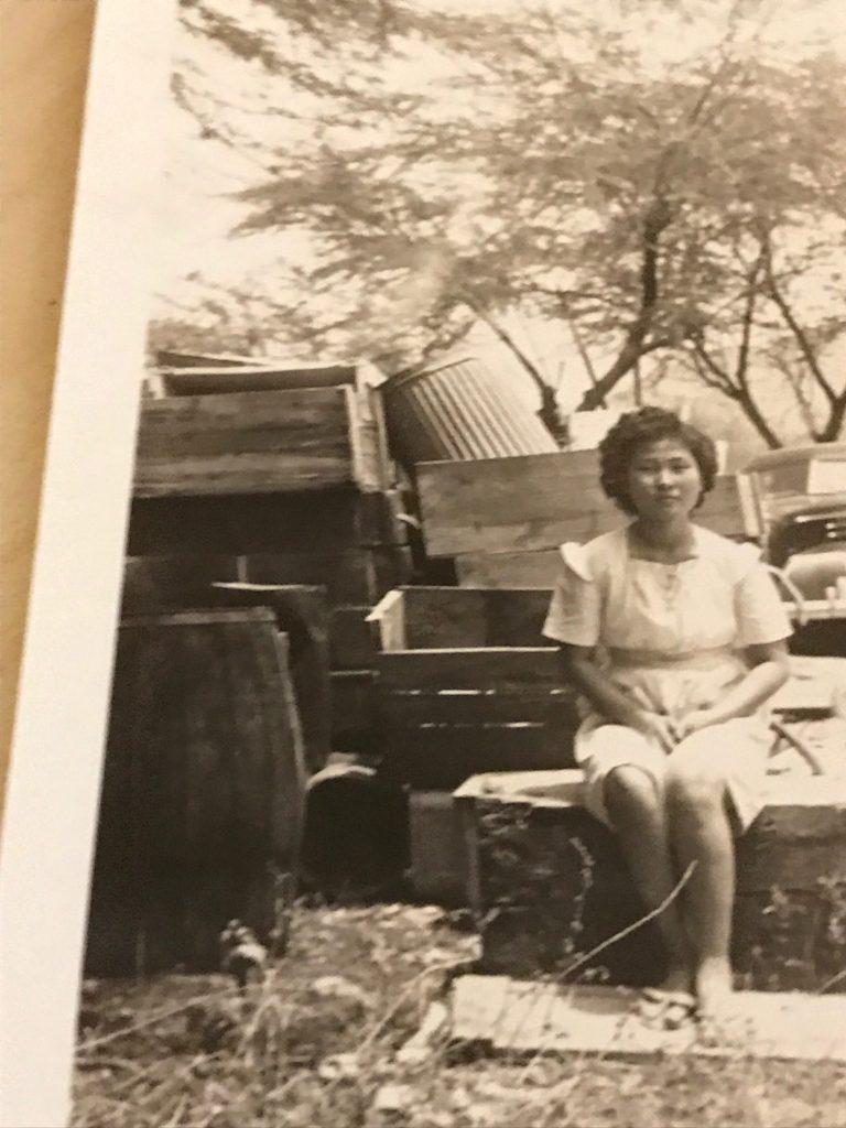 """Shigeo """"Robert"""" Muroda's daughter, June (Muroda) Hanabusa, in the parking lot of Honouliuli Internment Camp."""