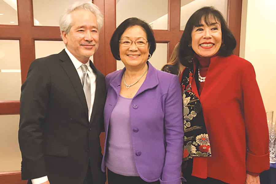 """Sen. Hirono at the U.S. Capitol on Feb. 14 with Karen Kore- matsu (far right), daughter of World War II internment resister Fred Korematsu and executive director of the Fred T. Korema- tsu Institute, and civil rights attorney Don Tamaki, who served on Fred Korematsu's coram nobis legal team. Earlier this year, Hirono and Illinois Sen. Tammy Duckworth introduced a resolution commemorating Jan. 30 as """"Fred Korematsu Day of Civil Liberties and the Constitution."""" It denounces any effort to discriminate againstan individualbased on national origin or religion. (Photo courtesy Office of U.S. Sen. Mazie Hirono)"""