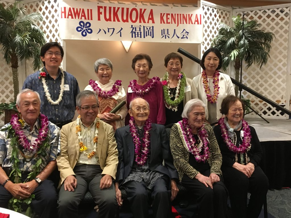 "Honoring the Keiro members (seated, from left): Wallace Inouye, age 80; Consul General of Japan Koichi Ito (seated, second from left), Kusuo Tada, age 102; Mabel Sekiya, age 88; and Nobue Akashi, age 99. Standing from left: Hawaii Fukuoka Kenjin Kai's newly installed president Keith Sakuda; Harriet Natsuyama, age 80; Clara Takiguchi, age 80; outgoing president Fusayo ""Fussy"" Nagai; and Misako Ito, wife of Consul General Ito."