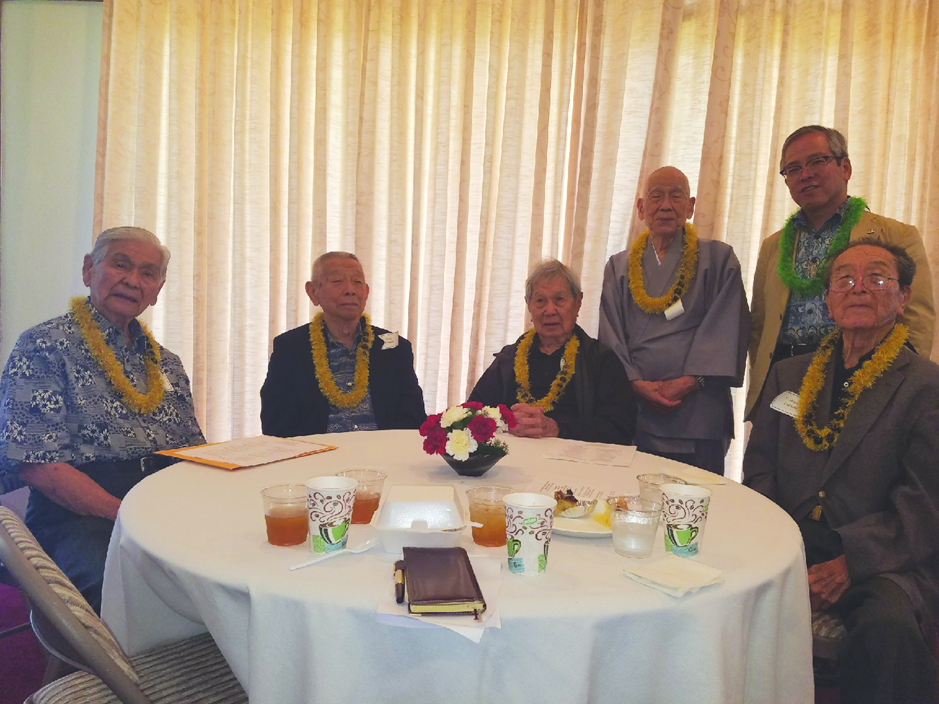 Several of the participants in the 2012 Zadankai (seated, from left) — former Gov. George Ariyoshi, Dr. Fujio Matsuda, Ted Tsukiyama and the Rev. Yoshiaki Fujitani, along with (standing, left) Bishop Ryokan Ara and Consul General of Japan Koichi Ito.