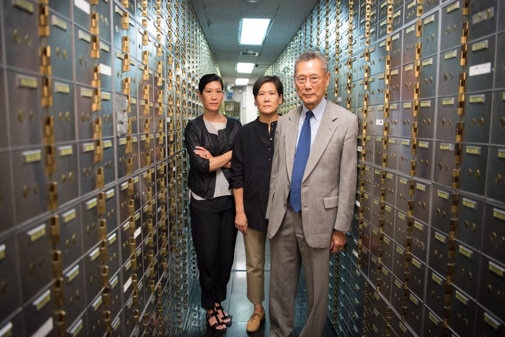 Thomas Sung and daughters Vera (left) and Jill in Abacus' vault containing more than 8,000 safe deposit boxes rented by the bank's customers. (Photo by Sean Lyness, courtesy PBS Hawai'i)