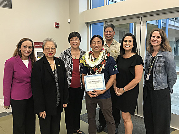 Ken Kakesako (center) with Stevenson principal Linell Dilwith (far left), DOE complex area superintendent for Kaimuki-McKinley-Roosevelt Ruth Silberstein, Noelani teacher Katherine Nakamura, and representatives of the Milken Foundation and Hawaii USA FCU. (Photo courtesy DOE)