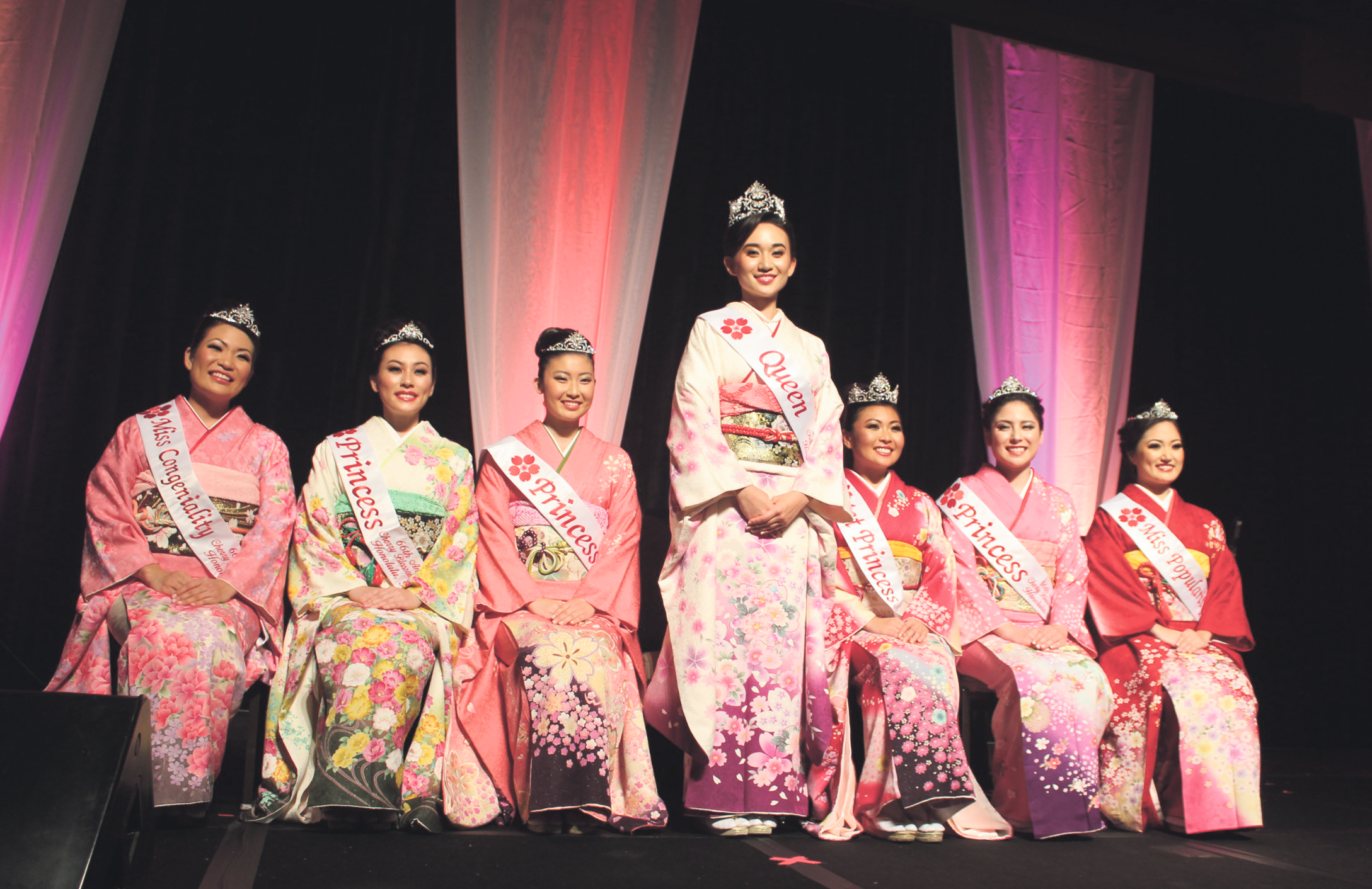 The 66th Cherry Blossom Festival Court, from left: Miss Congeniality Karly Kanehiro, Princess Kylie Hisatake, Princess Kaydi Hashima, Queen Melanie Carrié, First Princess Mika Nakashige, Princess Chelsea Briggs and Miss Popularity Sheby Meador. (Hawaii Hochi photos by Noriyoshi Kanaizumi)