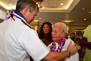Adm. Harris thanks 100th Battalion veteran Jack Nakamura for his service in World War II and wishes him well. (Photo by Ann Kabasawa)
