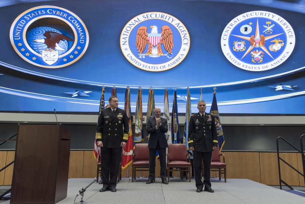 National Security Agency and commander, U.S. Cyber Command Gen. Paul Nakasone (right) and his predecessor Adm. Mike Rogers (left) on stage as Gen. Paul Nakasone receives fourth star. (Photos courtesy NSA)
