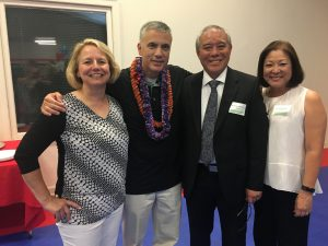 Gen. Paul Nakasone and his wife Susan relax with his cousin Norman Nakasone and his wife Renette after the May 4 change of command ceremonies. (Photo courtesy Norman Nakasone)