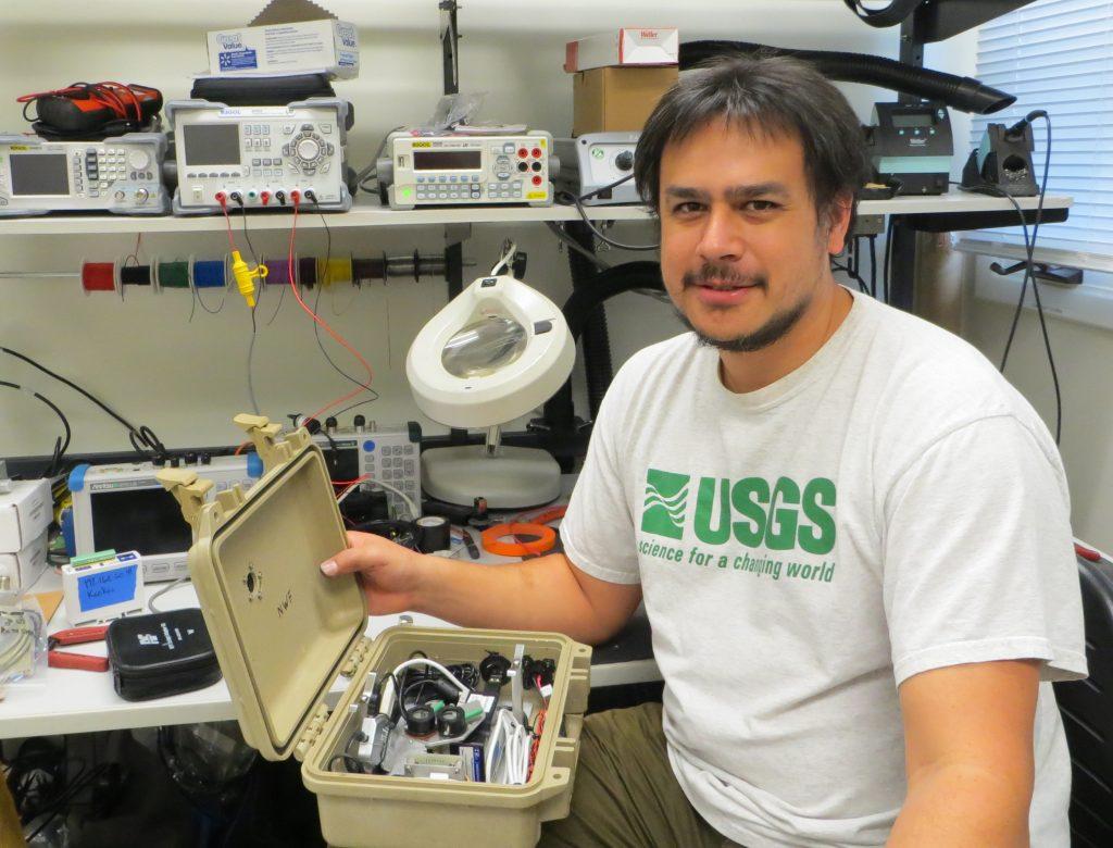 Kevan Kamibayashi prepares to dive into a project in his instrumentation lab at Hawaiian Volcano Observatory