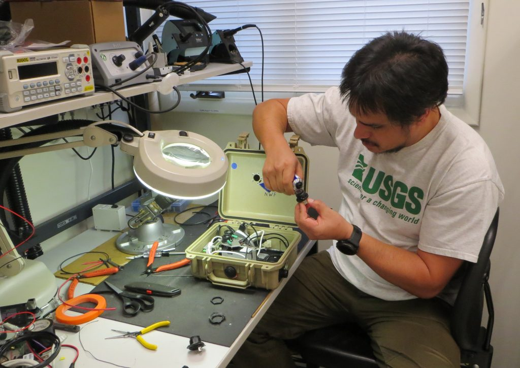 Kevan Kamibayashi prepares to dive into a project in his instrumentation lab at Hawaiian Volcano Observatory .. and then gets to work
