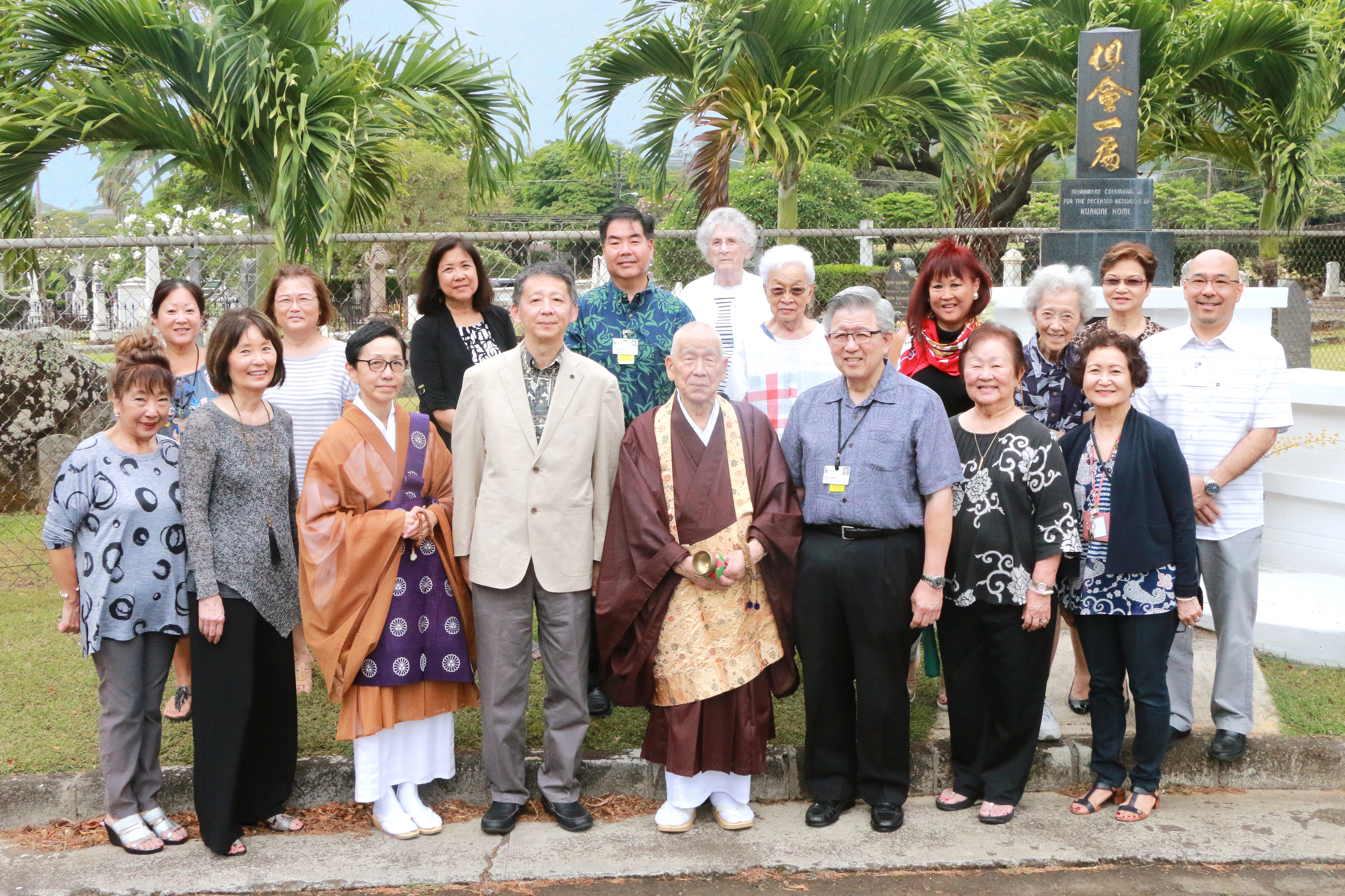 Members of the Kuakini Auxiliary, Kuakini Health System administration and Tendai Mission in front of the Kuakini columbarium following the May 29 memorial ceremony. Front row, from left: Memorial Project Committee chair Jinny Okubo; Kuakini Auxiliary president Karen Kuraoka; Rev. Ryodo Ishida of Tendai Mission; Alex Murata, president of the Tendai Mission support organization Ichigu Kai; Rev. Bishop Ryokan Ara of Tendai Mission; Gary Kajiwara, Kuakini president and CEO; Nancy Shimamoto with the Kuakini Auxiliary; and Suzette Lau-Hee from Kuakini Home. (Photo courtesy Kuakini Health System)