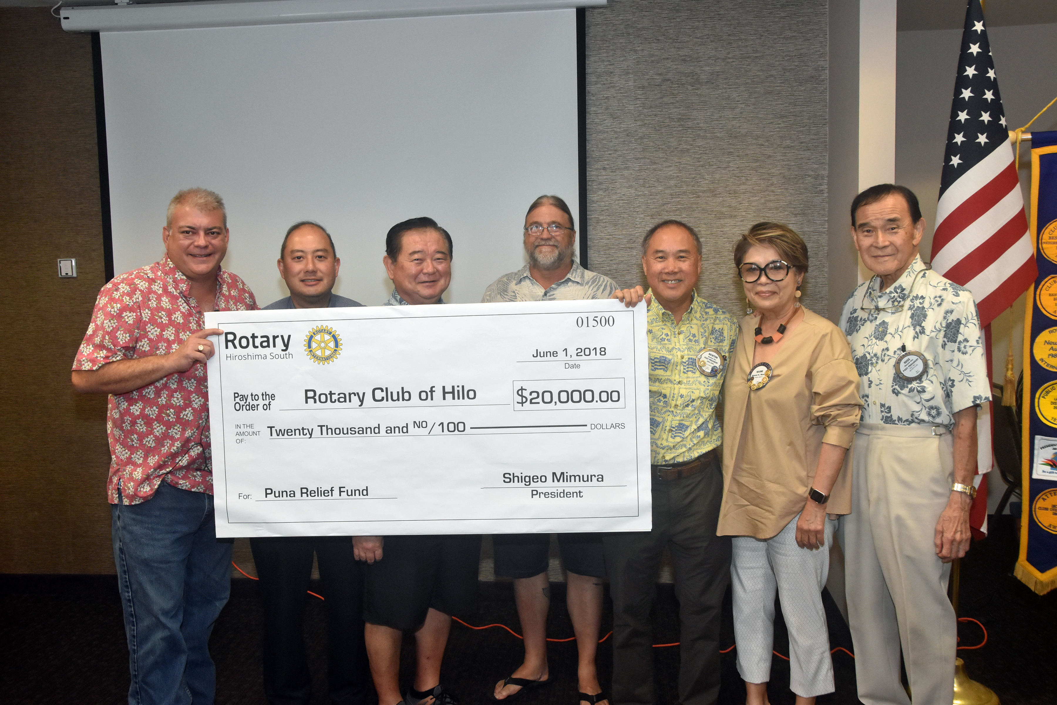 Rotary Club of Hilo president Steve Handy (far left) presents the $20,000 check from the Rotary Club of Hiroshima South in Japan to Pahoa Sunset Rotary Club president Ron Cutler (fourth from left). Handy was joined by Rotary Club of Hilo members (from left) Mitchell Dodo, Ed Hara, Newton Chu, Naomi Menor and Russell Oda, all of whom, except for Menor, are Rotary Club of Hilo past presidents. (Photo courtesy Ed Hara)
