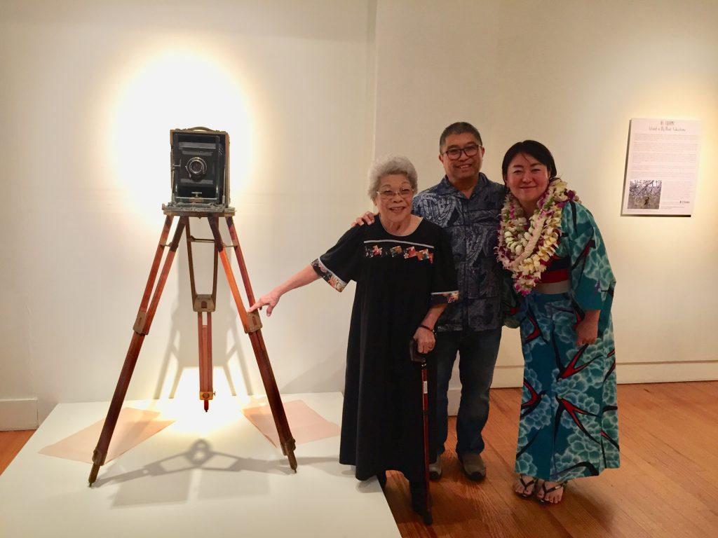 Photographer Ai Iwane with Florence Shimomura and her son, Rick, at the Nagamine Photo Studio. Rick Shimomura loaned Iwane the Kodak Cirkut camera that his late grandfather used to shoot Japanese funerals. (Photo by Kay Fukumoto)