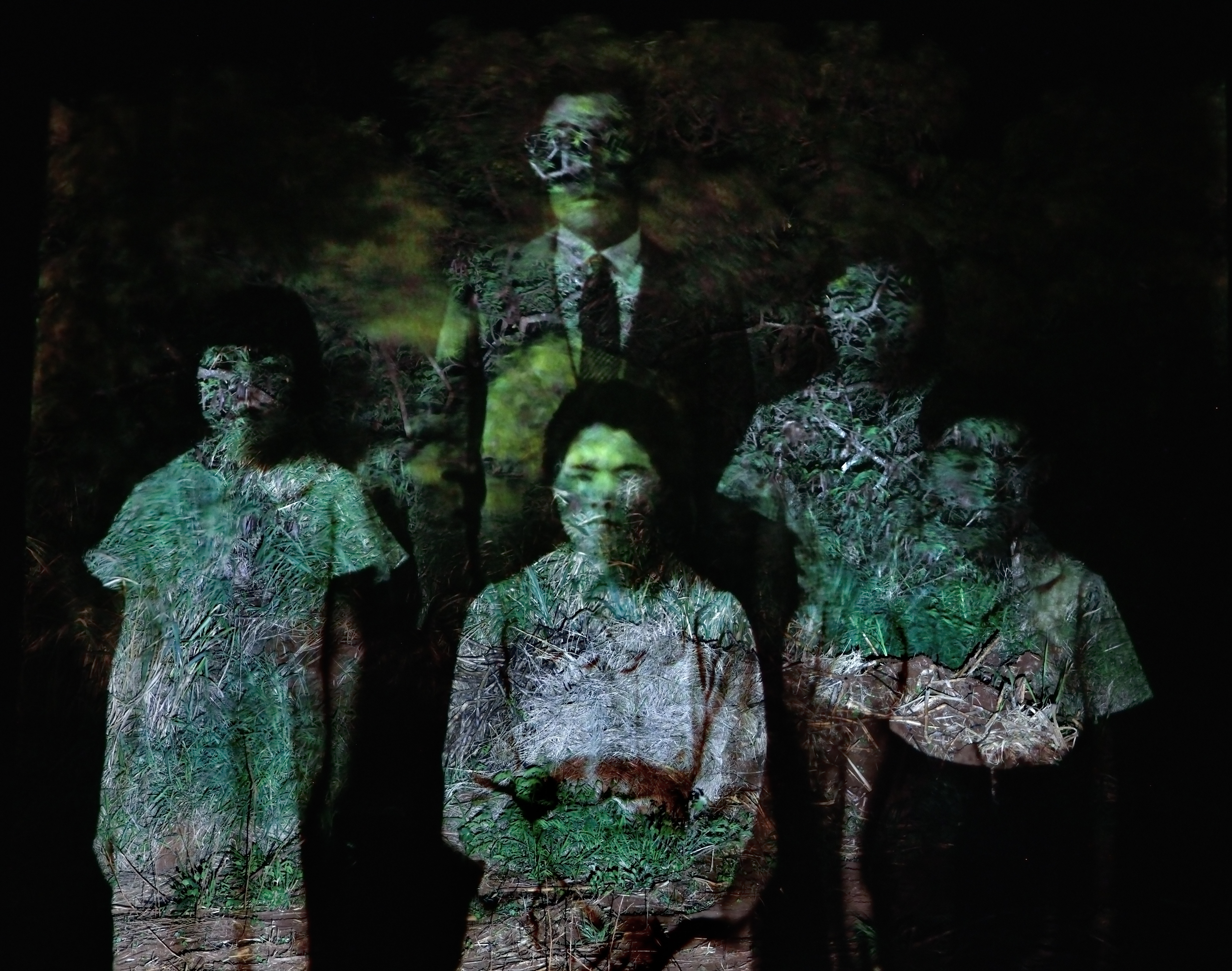 """In her companion exhibit at the MACC, Ai Iwane pays tribute to the Issei from Fukushima who taught """"Fukushima Ondo"""" to their neighbors in Keähua village in Pä'ia. In the above photo, Ai Iwane projected a family photo of Shosuke Nihei from Kailua Camp onto current landscape from the area."""