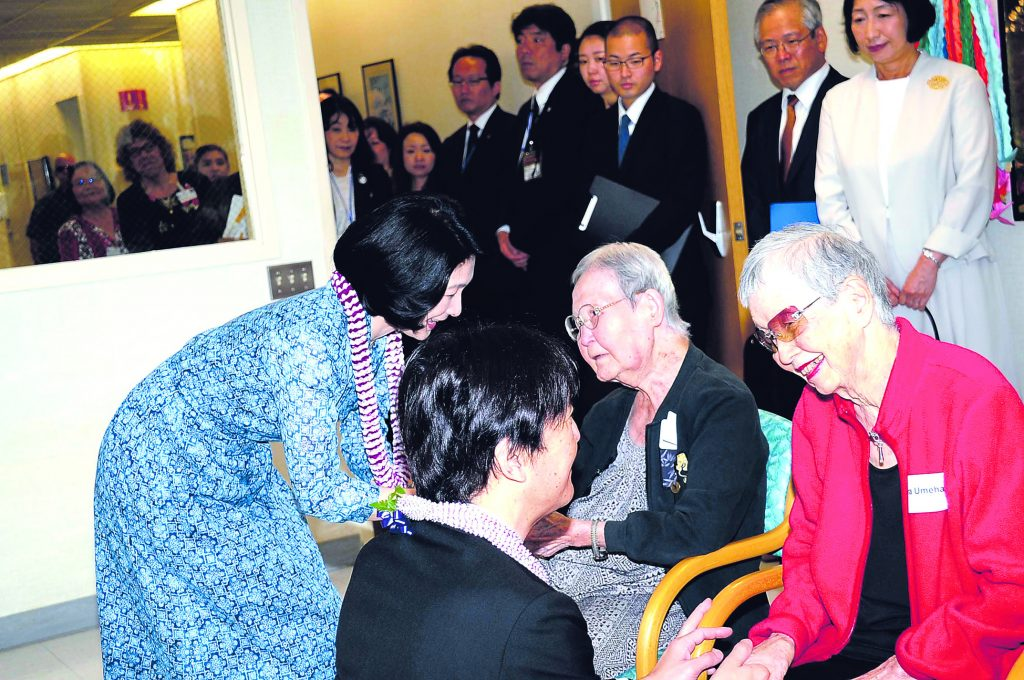 "Prince Akishino and Princess Kiko visiting with residents of Kuakini Home. ""Several of them offered us kind words and a welcoming handshake that conveyed their human warmth,"" the prince and princess wrote of their visit. (Photo by Alex Murata)"