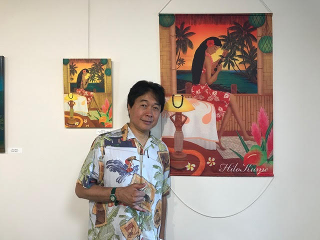 Hilo Kume with his paintings.