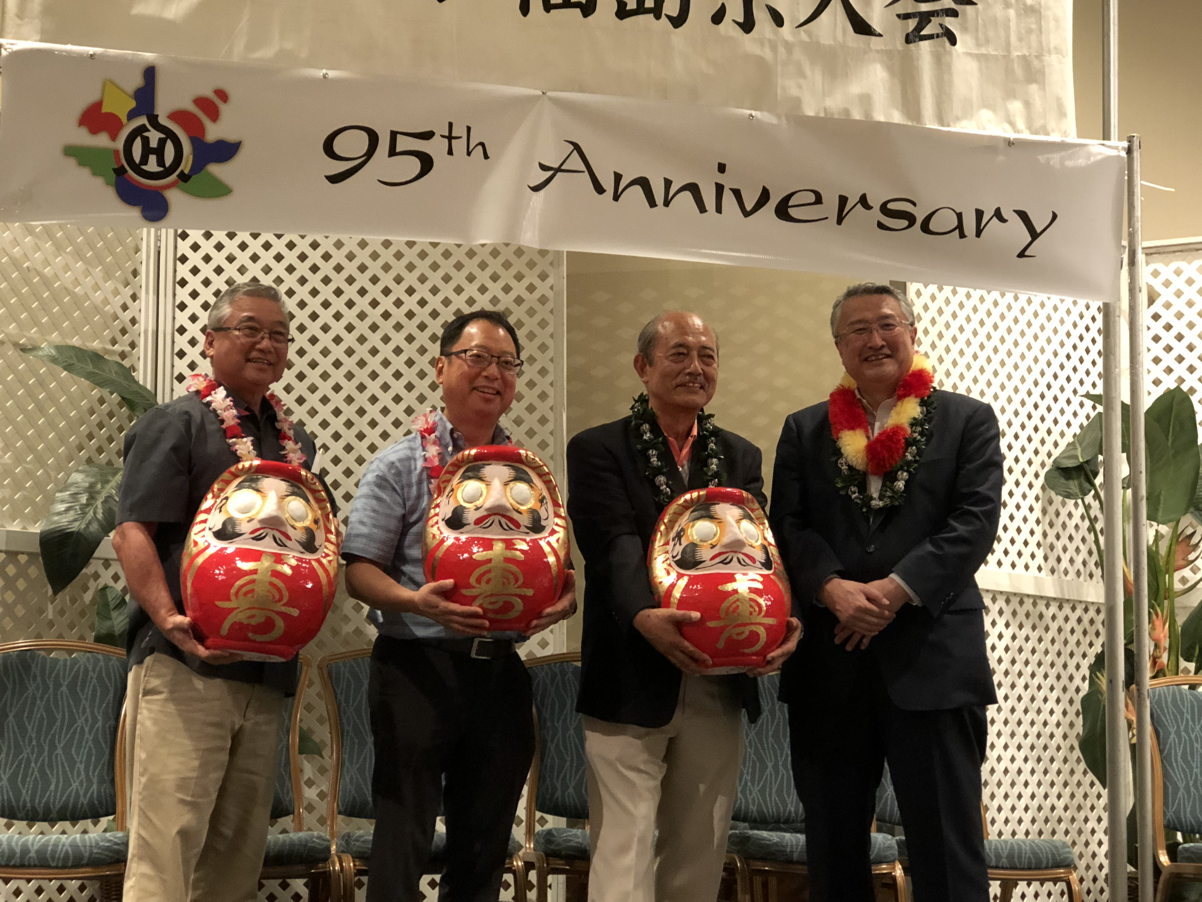 Fukushima Vice Gov. Masaaki Suzuki presented made in Fukushima daruma (traditional Japanese doll symbolizing perseverance and good luck) to the three Hawai'i Fukushima kenjinkai presidents (from left): Winston Towata of Hawaii-Shima Fukushima Kenjin Doshi Kai; Brian Moto of Maui Fukushima Kenjin Kai and Wallace Y. Watanabe of Honolulu Fukushima Kenjin Kai.