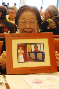 JWSF member and past president Lillian Yajima shows off the plaque that was presented to her for promoting JWSF.