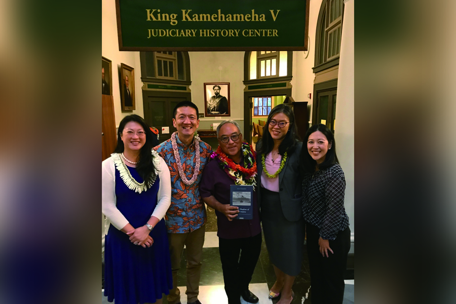 Group photo of Professor Eric Yamamoto with event sponsors - (from left) Mei-Fei Kuo, attorney and president of the National Asian Pacific American Bar Association, Hawai'i; Lt. Gov. Doug Chin; Claire Wong Black, attorney and president of the Federal Bar Association; and Liann Ebesugawa, attorney and past president of the Japanese American Citizens League, Honolulu. (Photo courtesy Eric Yamamoto)