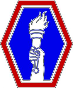 Hand holding torch symbol honoring 442nd/100th Battalion