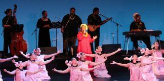 "Singer Karen Keawehawaii sings ""Kawa no Nagare no Youni"" as the hula halau, Ka Lä 'Önohi Mai O Ha'e Ha'e, dance hula to the song. The hula was choreographed by her daughter Tracie and her husband, Keawe Lopes, both of whom are kumu hula. (Photo courtesy Karen Keawehawai'i)"