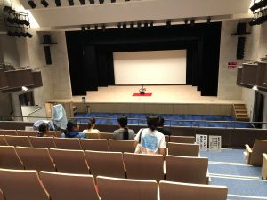An applicant practices on the test stage at the Ryukyu Shimpo.