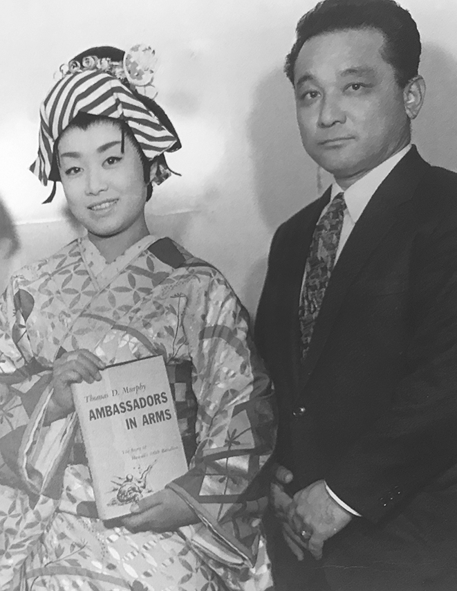 """100th Battalion veteran Shinko """"Thomas"""" Nohara is pictured with Misora Hibari after he presented her the book, """"Ambassadors in Arms,"""" the first postwar published history of the 100th Battalion. (Courtesy Misora Hibari Music Festival Committee)"""