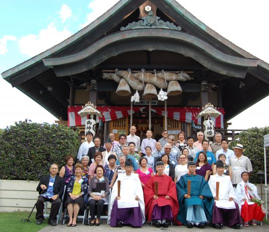 Izumo Taishakyo Mission of Hawaii members take a group photo in front of the shrine.