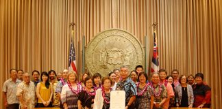 """Okinawan community members joined the """"Pigs from the Sea"""" families for the governor's proclamation presentation at his State Capitol office on Sept. 27."""