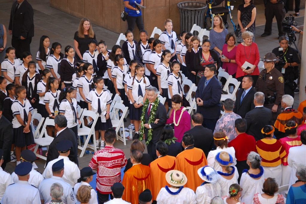 Gov. David Ige and his wife, Dawn Amano-Ige make their way to the inauguration stage as keiki to kupuna look on.