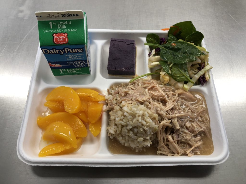 The special Thanksgiving school lunch included roast turkey with gravy, brown rice, peaches, green salad, a square of Okinawan Sweet Potato Pie and milk.