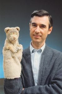 """Fred Rogers with """"Daniel Tiger"""" from his show, """"Mr. Rogers' Neighborhood."""" (Credit: The Fred Rogers Company)"""
