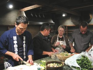 Alan and Ed cooking with Tadaaki and Nancy Hachisu in the kitchen of their 80-year-old farmhouse in Saitama.