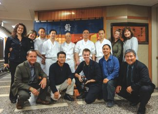 "The ""Family Ingredients"" crew with Chef Jiro Ono outside his Tökyö restaurant: Kneeling, from left: Chef Ed Kenney, producer Dan Nakasone, cinematographer Todd Fink, director Ty Sanga and Chef Alan Wong. Back row, from left: director of photography Renea Veneri Stewart, executive producer Heather Giugni, Jiro's apprentices in whites with chefs Jiro-san and Yoshikazu-san (fifth and sixth from left), Japan coordinator Nancy Singleton Hachisu and Leigh Ito, vice president, Alan Wong's Restaurants. Missing from photo: sound engineer John Saimo. (Photos courtesy Dan Nakasone)"