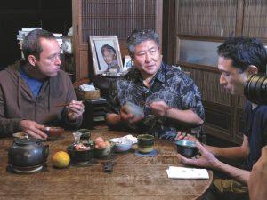 Ed and Alan eating tamago kake gohan as Tadaaki prepares it.