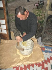 Ed grinding soybeans to make fresh tofu at one of the farms the crew visited.