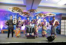 "The 2019 cast of the ""Shoko Shiranami Gonin Otoko"" performance. Kneeling in front is the Kojyo, played by Chef Alan Wong. Standing from left are: Meakashi Kingoro (Kevin Ching), and dorobo Nango Rikimaru (Kristin Alm Kamakahi), Akaboshi Jyuzaburo (Daisuke ""Duke"" Ueda), Tadanobu Rihei (Ray Tsuchiyama), Benten Kozo Kikunosuke (Jennifer Okubo) and Nippon Daemon (Ala Kinuhata)."