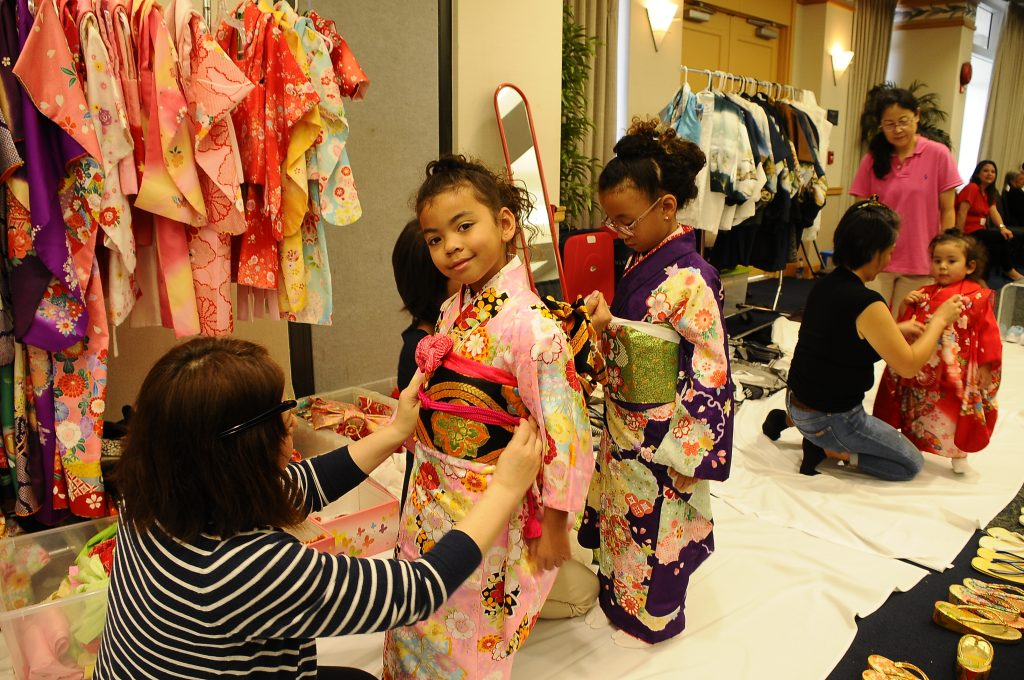 The Lynch sisters — (from left) 6-year-old Grace, 7-year-old Helen and 2-going-on-3-year-old Elsie Sue — get dressed up in kimono. The girls' mother, Kristine Lynch, a yonsei, said it was the first time her daughters had gotten dressed up in kimono.