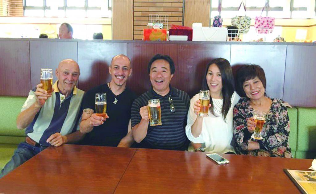 Enjoying a beer in Okinawa last November. From left: David and Michael (Glenn's half-brother) Boughton, Glenn and Miki Wakai and Yoko Boughton.