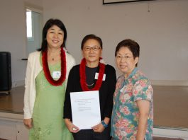 JWSF president-elect Melanie Takahashi (far right) presents UH Culture Day program co-chairs Yuka Wada (far left) and Dr. Tomoko Iwai a grant check for $1,000.