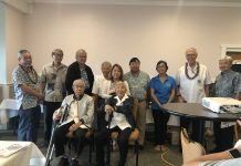 The 2019 officers and directors: (seated) directors Herbert Matsumoto and Yoshinobu Oshiro; (standing, from left): directors Mark Matsunaga, Keith Matsumoto, Gregg Hirata, vice president Shinye Gima, director Annie Inouye, treasurer Sherman Takao, secretary Karen Aoyama Kikukawa, president Lawrence Enomoto and installing officer Wallace Hirai. (Photo by Karen Matsunaga)