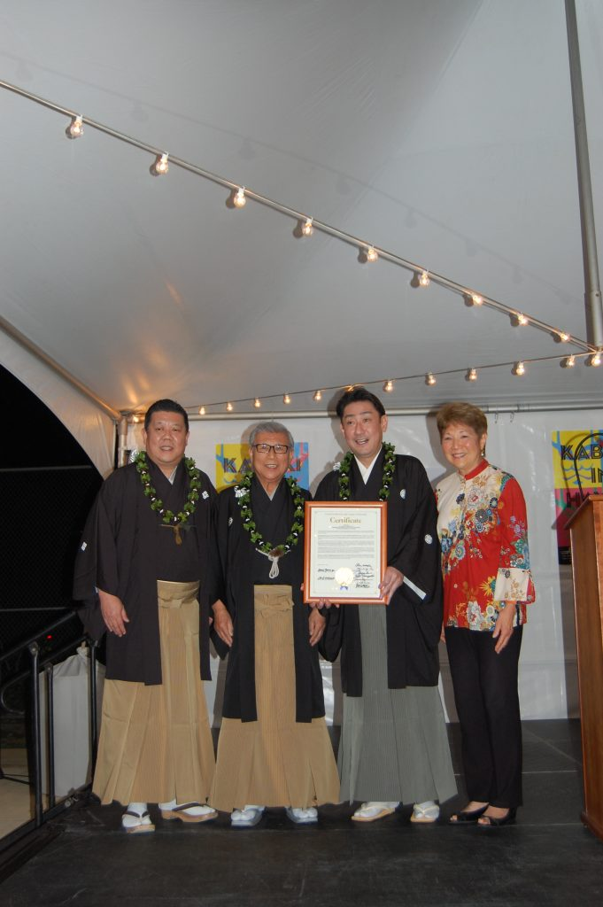 Honolulu City Councilmember Carol Fukunaga presented a congratulatory certificate from the City Council to (from left) San'emon Tobaya, Richo Tobaya and Shikan Nakamura at a reception at the Japanese Consulate. (Photo by Jodie Ching)