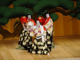 "The kabuki play, ""Renjishi,"" is the story of the white-haired father shishi (mystical lion) and his two red-haired shishi cubs. The opening of the play is told through a dance with puppets. From left: Fukunosuke Nakamura, Shikan Nakamura (front) and Hashinosuke Nakamura. (Photo by Wayne Shinbara)"
